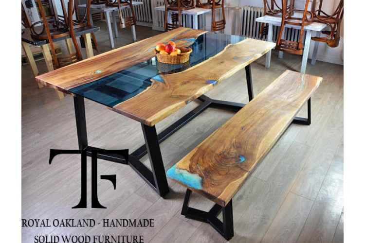 Dining table with bench made of wood and bright blue epoxy resin by